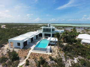 sandy-bottom-villa-luxury-turks-and-caicos-islands-vacation-rental-pool-beach